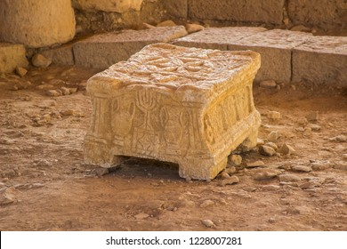 the ancient Magdala stone located in a 1st century synagogue dig located in the village of Magdala in Galilee Israel. This unique piece is yet to fully unfold its secrets