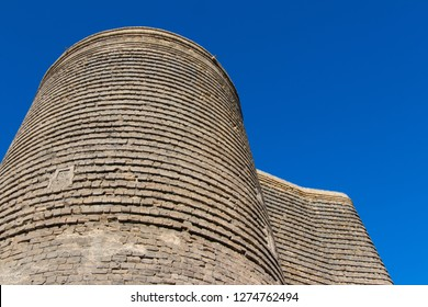 Ancient Maiden Tower in Baku Old Town. Azerbaijan Maiden tower architecture. Ancient construction with stone walls