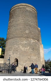 Ancient Maiden Tower (Giz Galasi) in Baku Old Town. Azerbaijan Maiden tower architecture. Tourists in front of Maiden Tower. Baku - Azerbaijan 10 October 2018