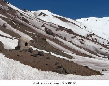 Ancient mailmen refuge on the snow-covered mountain. Location: The Andes (mountain chain), province of Mendoza, Argentina