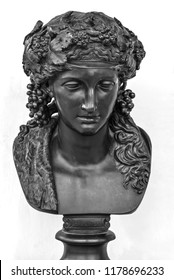 Ancient male statue isolated on white background. Greek god of wine Bacchus bust. Public domain. Mythology bronze character, beautiful face closely. Dionysus portrait for calendar, prints, posters
