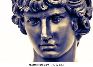 Ancient male statue of Mercury of 18th century isolated on white background. Public domain. Beautiful face closely. Greek god Hermes of speed for design, posters, prints, art calendar. Bronze statue.