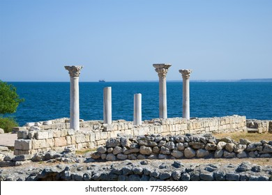 Ancient marble columns on the background of the Black Sea. Ruins of ancient Chersonesos, Crimea