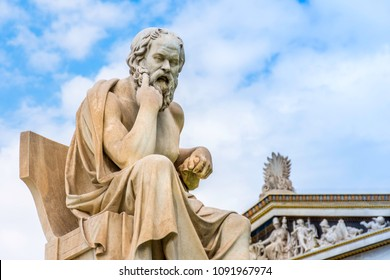 Ancient marble statue of the great Greek philosopher Socrates on background the blue sky, Athens, Greece