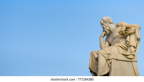 Ancient marble statue of the great Greek philosopher Socrates on background the blue sky.