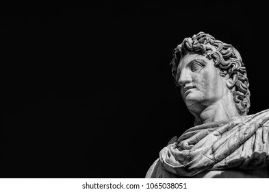 Ancient marble statue of mythical character Castor or Pollux, dated back to 1st century BC, located at the top of monumental balustrade in Capitoline Hill, in Rome (Black and White with copy space)