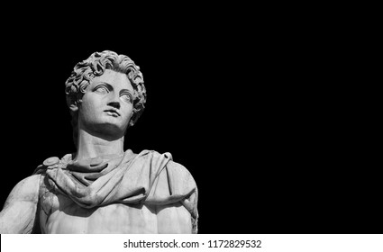 Ancient marble statue of mythical character Castor or Pollux, dated back to the 1st century BC, at the top of monumental balustrade in Capitoline Hill, in Rome (Black and White with copy space)