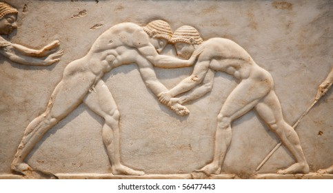 Ancient marble tablet showing Greek fight