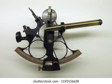 Ancient marine bronze navigation sextant Astrolabe on white background