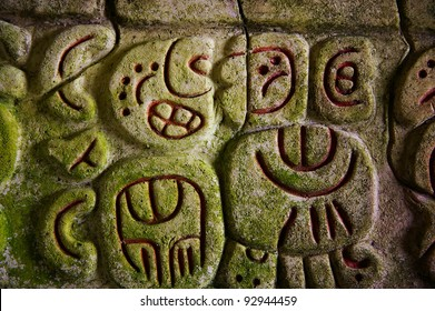 Ancient Mayan hieroglyphics in stone, from the ruins at Caracol, Belize