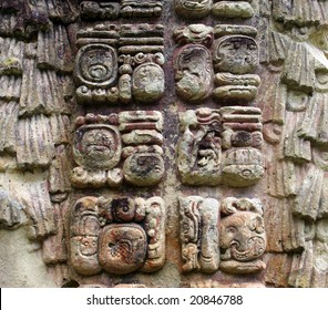 Ancient Mayan hieroglyphs on the wall of Copan, Honduras