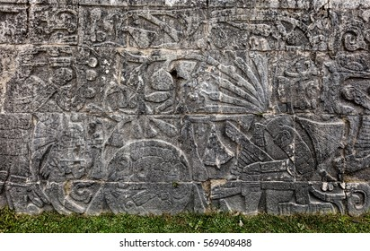 Ancient Mayan mural at the Great Ball Court in Chichen Itza depicting headless body of a player with the snakes streaming out of the neck. The ball game was symbolic of death and rebirth.