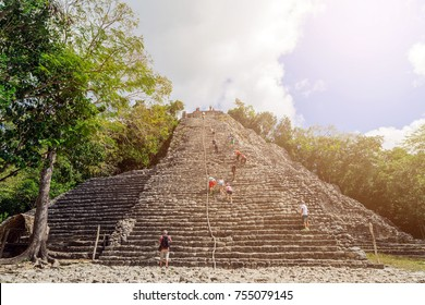Ancient Mayan pyramids in the jungle Coba. Archaeological excavations of the Pyramid of Coba, Yucatan, Mexico. Sun rays and scattered light