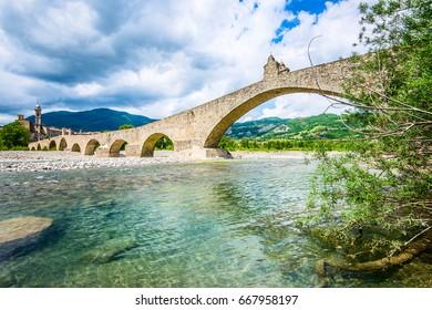 ancient medieval bridge and village - italian landscape Emilia Romagna Italy