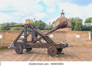 Ancient medieval catapult and cannon balls at the tower of the Sant'Angelo Castel ( Famous Roman landmark ). Rome. Italy. Europe.