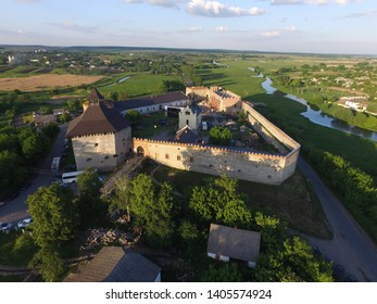 Ancient medieval fortress in the village of Medzhybizh (Ukraine), aerial view. One of the strongest fortresses in Podilia in a beautiful spring or summer evening. Landscape with castle and river.
