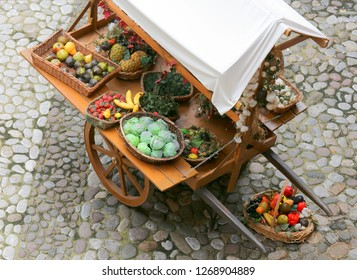 ancient medieval greengrocer's cart with fresh fruit and vegetables for sale on the street