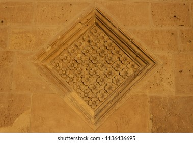 Ancient medieval squared floreal stone decoration