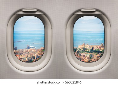 Ancient mediterranean city viewed from inside an airplane windows