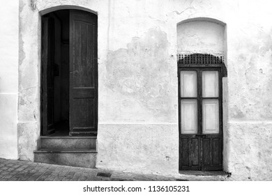 Ancient mediterranean doors. The pass of time... Black and white