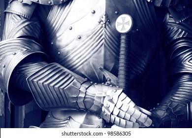 Ancient metal armor in sepia.