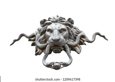 Ancient metal door handle in the form of a lion's head, isolated on white background