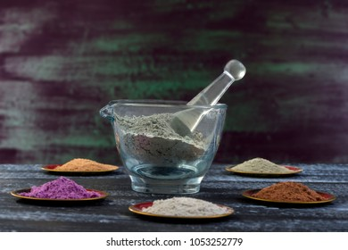 Ancient minerals - Clay of several colorsclay powder and mud mask for spa, beauty concept on black
