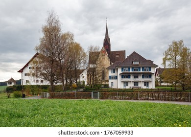 Ancient monastery Kloster Kappel on a cloudy spring day. Municipality Kappel am Albis, Affoltern district, canton of Zuerich in Switzerland.