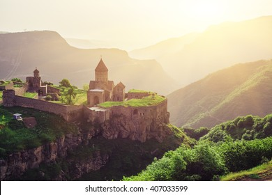 Ancient monastery in setting sun. Tatev. Armenia