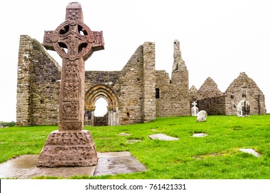 The ancient monastic city of Clonmacnoise with the typical crosses and graves, Ireland