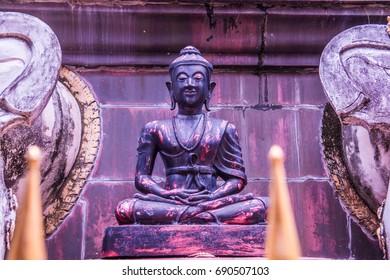 Ancient monk statue in Phra That Suthon Mongkhon Khiri temple, Thailand.