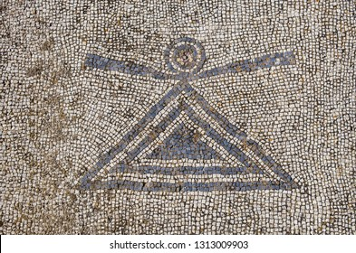 Ancient mosaic floor at the archeological site of Delos island, in Greece, with the symbol of Tanit (an ancient goddess of Phoenician ancient culture).