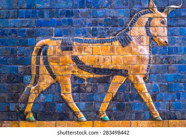 Ancient mosaic on the Ishtar Gate wall with mythical bull, Istanbul museum. Babylonian mosaic, fragment of the Ishtar Gate.