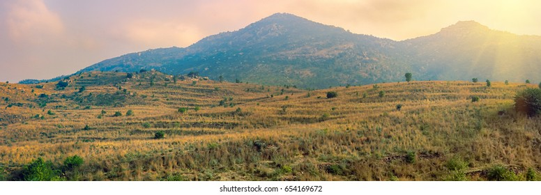 Ancient mountain country. Panorama of Deccan plateau (India) with Bush clad hills and prairie on the site of the former scrub and forests (abandoned agricultural land - terraced farming after)