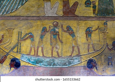 Ancient mural of an egyptian boat with gods on wall in tomb