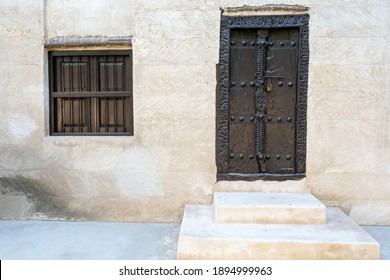 Ancient Museum doors and barred window of a middle eastern fort at the Ras al Khaimah Museum in the United Arab Emirates.