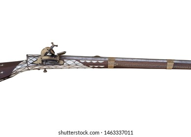 Ancient musket isolated on white background. Antique flintlock rifle.