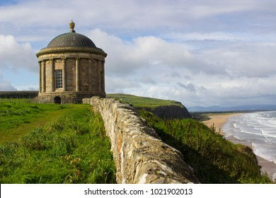 The ancient Mussenden Temple Monument on the clifftop edge overlooking Downhill Beach in County Londonderry Northern Ireland