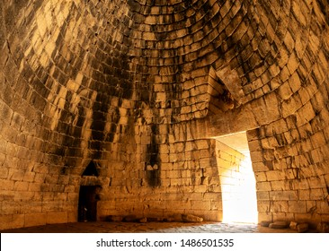 "ANCIENT MYCENAE, ARGOLIS, PELOPONNESE, GREECE- Aug 01, 2019. Inside the ""Treasury of Atreus"" (also known as the ""Tholos tomb of Atreus"" or ""Tholos tomb of Agamemnon"")."