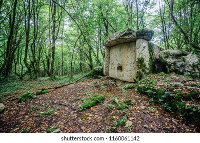 Ancient mysterious megalithic construction dolmen in Abkhazian forest, Azanta, Abkhazia
