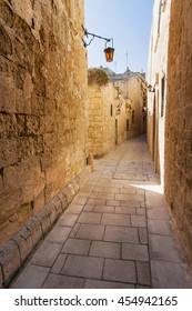 Ancient narrow street in Mdina, old capital of Malta.