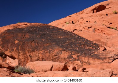 the  ancient native american petroglyphs along the petroglyph canyon trail near mouse's tank  in the   arid and eroded desert landscape of valley of fire state park, near overton, nevada