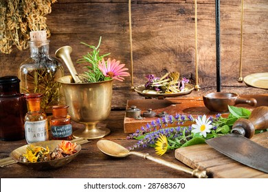 Ancient natural medicine, herbs, vials and old apothecary scales on wooden background