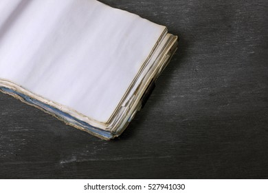 Ancient notebook open on the wood texture background, Diary with blank pages, Blank book on wooden, Blank pages, Dirty paper