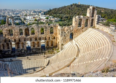 Ancient Odeon of Herodes Atticus in Athens, Greece on Acropolis hill with view over the city.