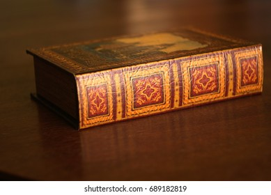 ancient old books on a wooden table with textured editing