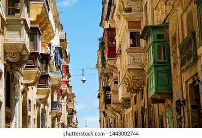 ancient old houses around narrow street in Mediterranean island Malta