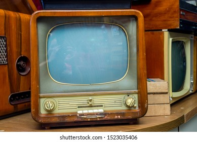 Ancient old television set show in the electrical stores. Old vintage television set.