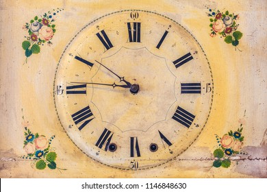 Ancient ornamental clock with hand painted floral decoration