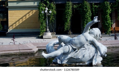 Ancient ornamental statues silhouette fountain in Bad Ischl